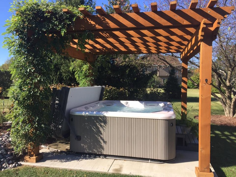 A pergola is a great hot tub privacy solution. - Creating Home Hot Tub Privacy
